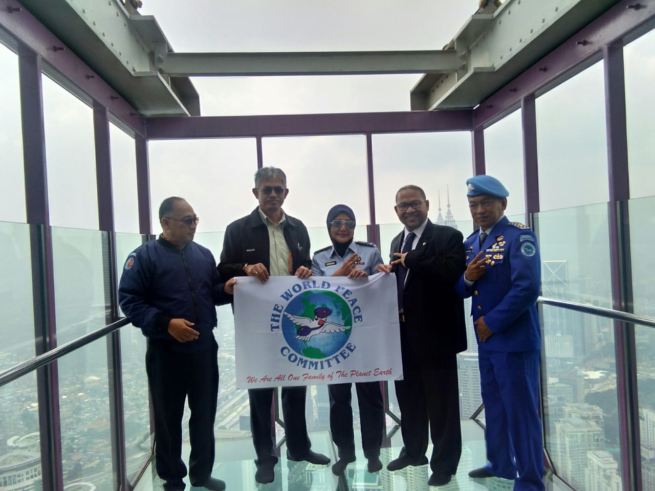 President of The World Mr Djuyoto Suntani places World Peace Gong at KL Tower Malaysia